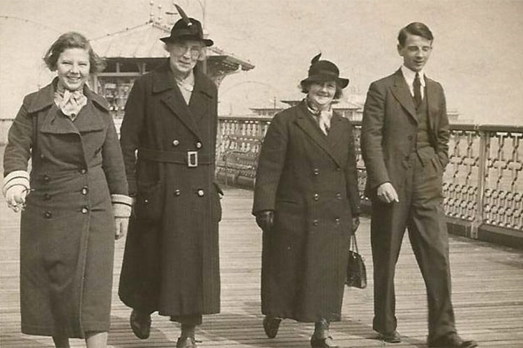 Edith Rigby, second from the left, walking on a Pier